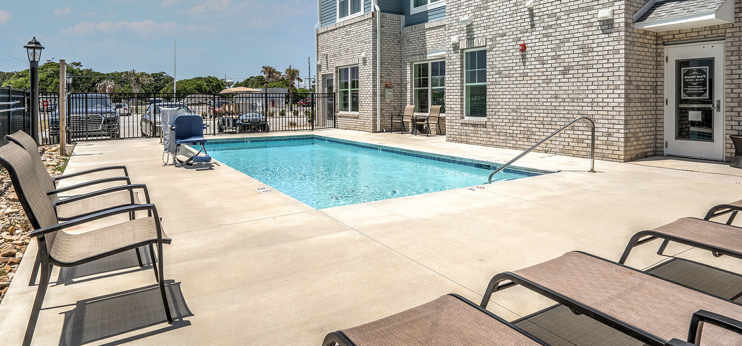 Discover The Elegant Lighthouse Inn & Suites Enjoy a Swim in Our Sparkling Pool